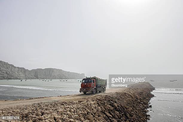 A truck reverses while delivering rocks to a development site on Marine Drive in Gwadar Balochistan Pakistan on Wednesday Aug 3 2016 Gwadar is the...