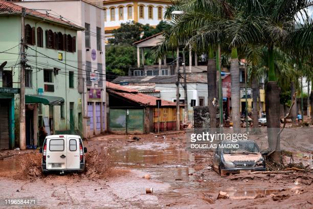 Truck rides along a flooded street after the overflowing of the Das Velhas River in Sabara, Belo Horizonte, Minas Gerais state, Brazil, on January 26...