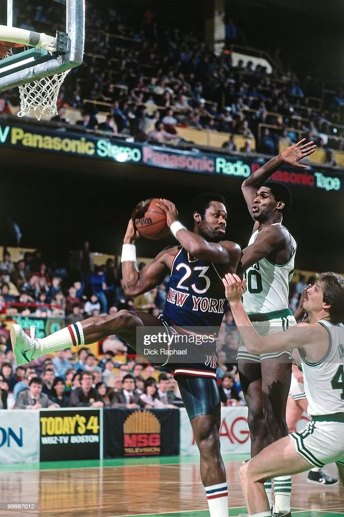 Truck Robinson #23 of the New York Knicks rebounds against Robert Parish #00 of the Boston Celtics during a game played in 1983 at the Boston Garden in Boston, Massachusetts.