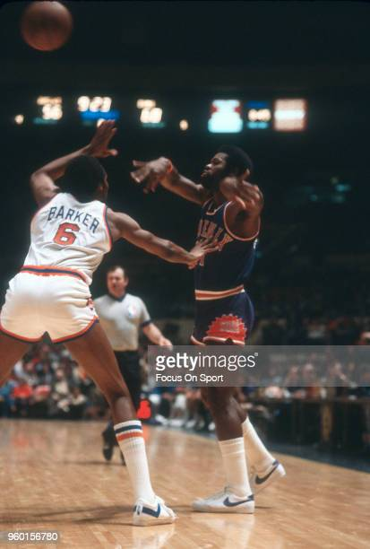 Truck Robinson of the Phoenix Suns passes the ball over the top of Tom Barker of the New York Knicks during an NBA basketball game circa 1979 at...