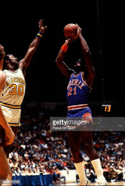 Truck Robinson of the Phoenix Suns shoots over George McGinnis of the Indiana Pacers during an NBA basketball game circa 1980 at Market Square Arena...
