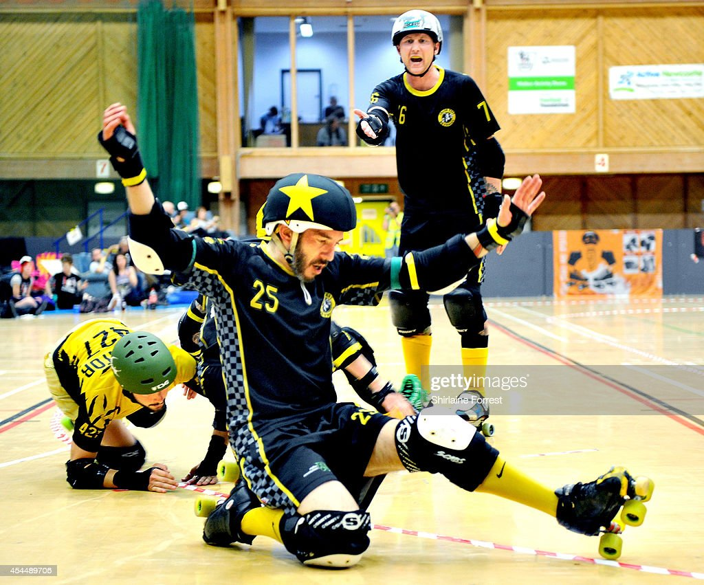 Truck Rogers and Illbilly of Crash Test Brummies and Aligator of Panam Squad bout in the Men's European Cup roller derby tournament at Walker Activity Dome on August 31, 2014 in Newcastle upon Tyne, England.