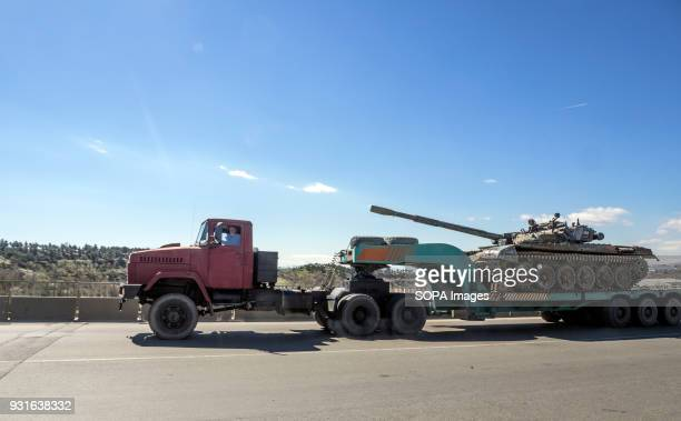 A truck seen carrying on the platform a T64 tank near Tbilisi