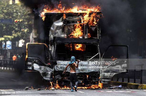 TOPSHOT A truck set ablaze by opposition activists blocking an avenue during a protest burns in Caracas on July 18 2017 The Venezuelan opposition...