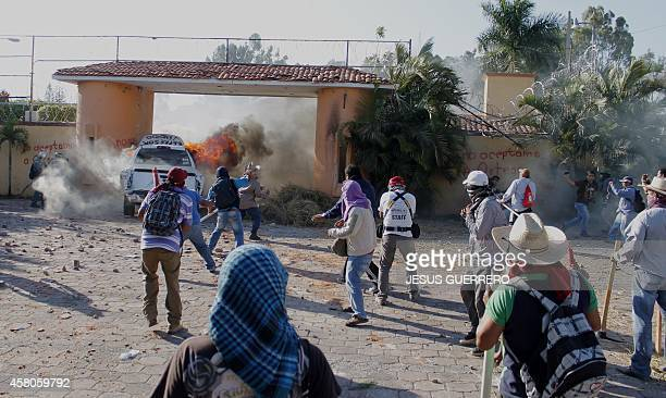 A truck set on fire breaks open one of the entrances of the governor's house in Chilpancingo Guerrero state on October 29 by teachers protesting for...