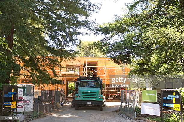 A truck sits in front of a house under construction on San Mateo Drive in the Willows neighborhood of Menlo Park California US on Tuesday May 22 2012...