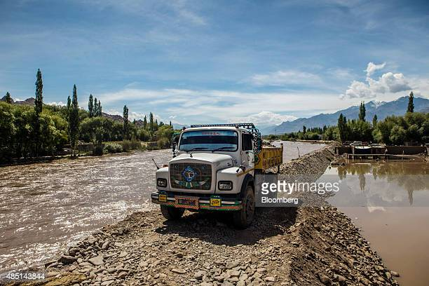 Truck sits parked beside the Indus River in Ladakh region, Jammu and Kashmir, India, on Saturday, Aug. 8, 2015. India is scheduled to release...