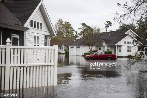 A truck sits partially submerged in a flooded neighborhood after Hurricane Florence hit in Wilmington North Carolina US on Saturday Sept 16 2018 In...