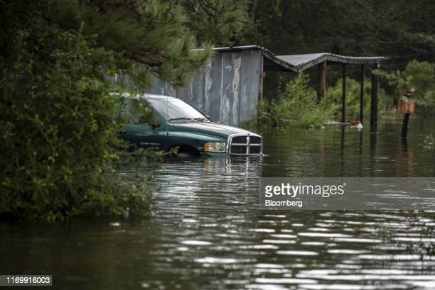 A truck sits submerged in flood water following Tropical Storm Imelda in Fannett Texas US on Friday Sept 20 2019 The remnants of Tropical Storm...