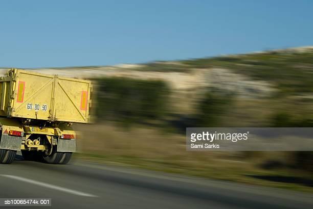 Truck speeding on highway (blurred motion)