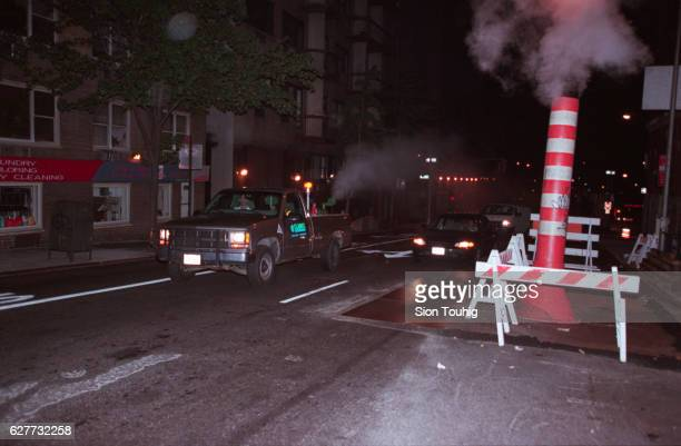 A truck sprays pesticide against mosquitos which may carry the West Nile Virus on the streets of Manhattan