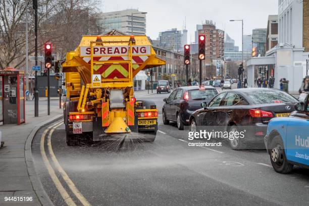 Truck spreading salt on the road