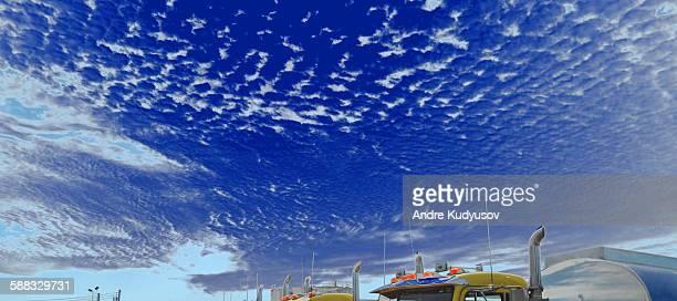 Truck stop against cloudscape