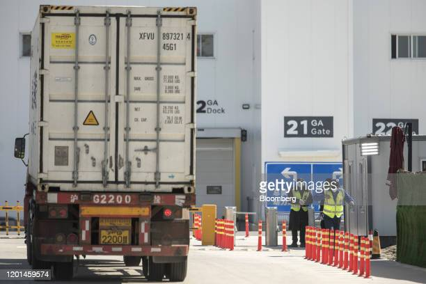 A truck stops in front of the Tesla Inc Gigafactory in Shanghai China on Monday Feb 17 2020 Tesla has fully resumed deliveries of its Chinabuilt...