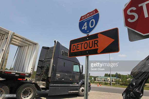 Truck takes a detour off Interstate 40 to avoid a stretch of the highway flooded by the White River May 8, 2011 near Carlisle, Arkansas. Motorists...