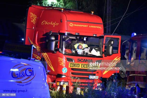 A truck that had stopped on train tracks and was subsequently hit by a train is seen in Caluso outside Turin on May 24 2018 Two people were killed...