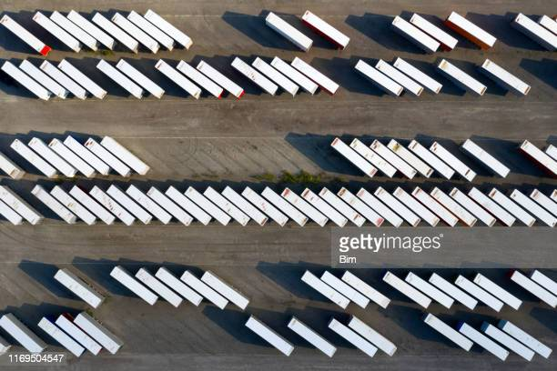 truck trailers and shipping containers, aerial view - refrigerator truck stock pictures, royalty-free photos & images