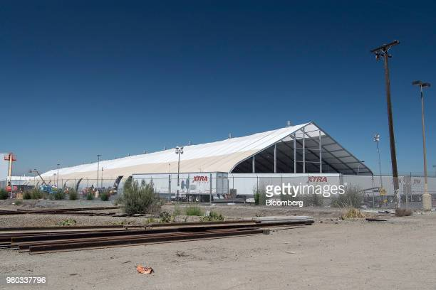 Truck trailers sit parked outside a newly constructed production tent at the Tesla Inc manufacturing facility in Fremont California US on Wednesday...