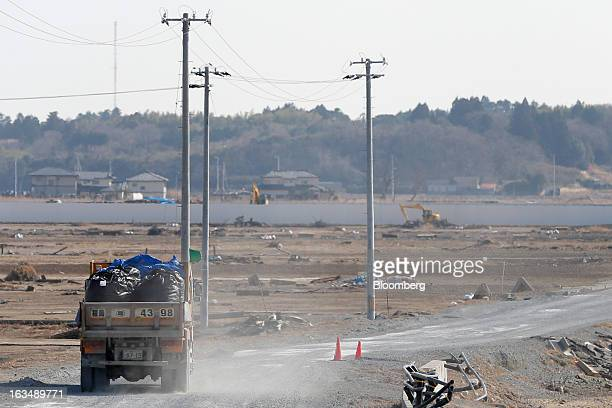 A truck transporting bags of debris drives through an area destroyed by the tsunami following the Great East Japan Earthquake in Minamisoma Fukushima...