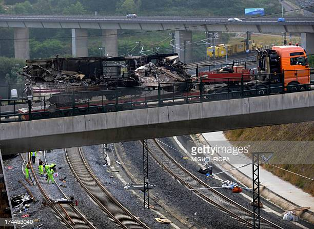 A truck transports a carriage from the scene of a train crash on July 26 2013 at Angrois near Santiago de Compostela Spain A train hurtled off the...