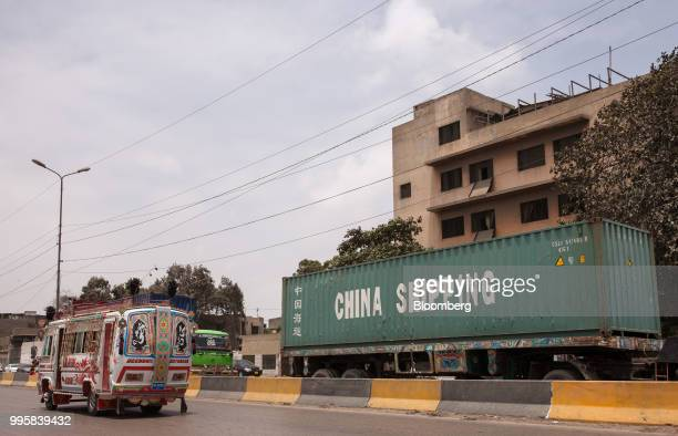 Truck transports a China Shipping Container Lines Co. Container along Karachi port road in Karachi, Pakistan, on Monday, July 9, 2018. The Pakistan...