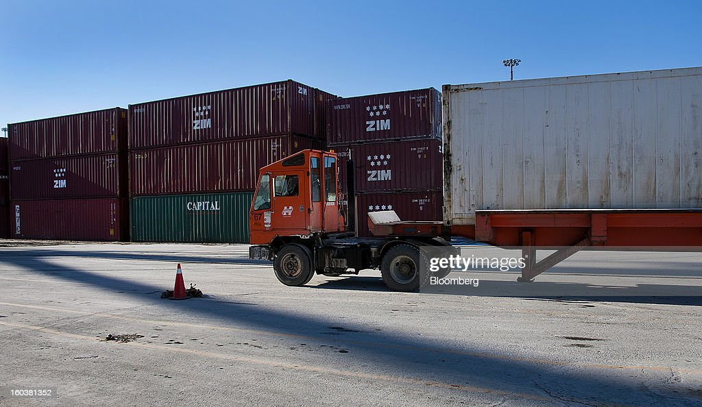 A truck transports a freight container at the Port Of Halifax's South End container terminal, operated by Halterm Ltd., in Halifax, Nova Scotia, Canada, on Tuesday, Jan. 29, 2013. Statistics Canada (STCA) is scheduled to release gross domestic product data on Jan. 31. Photographer: Aaron McKenzie Fraser/Bloomberg via Getty Images