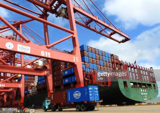 A truck transports containers at a port in Lianyungang in China's eastern Jiangsu province on July 13 2018 China's surplus with the United States hit...