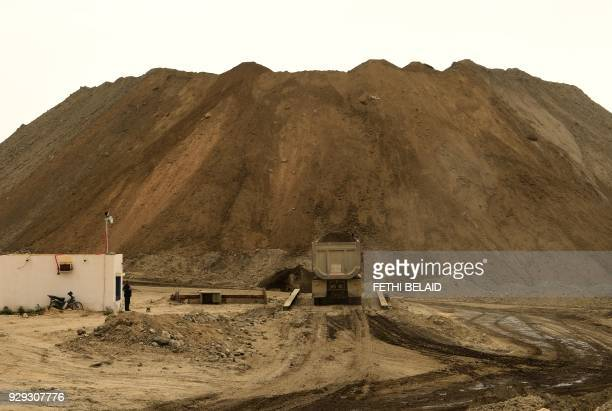 A truck transports earth the Metlaoui phosphate production plant on March 8 in the Metlaoui mining region one of the main mining sites in central...
