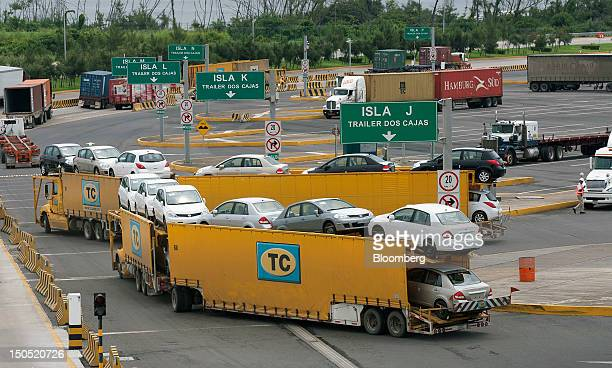 A truck transports new Volkswagen AG cars at the Port of Veracruz Mexico on Friday Aug 17 2012 Mexico's economic growth slowed less than analysts...