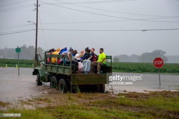 TOPSHOT A truck transports nursing home staff and patients during the evacuation of a nursing home due to rising flood waters in Lumberton North...