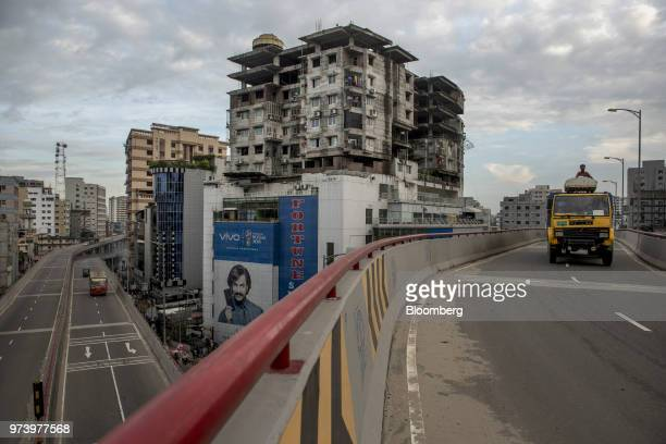 A truck travels along the Moghbazar Mouchak flyover in Dhaka Bangladesh on Wednesday June 6 2018 The Bangladesh economy will expand 69% this...