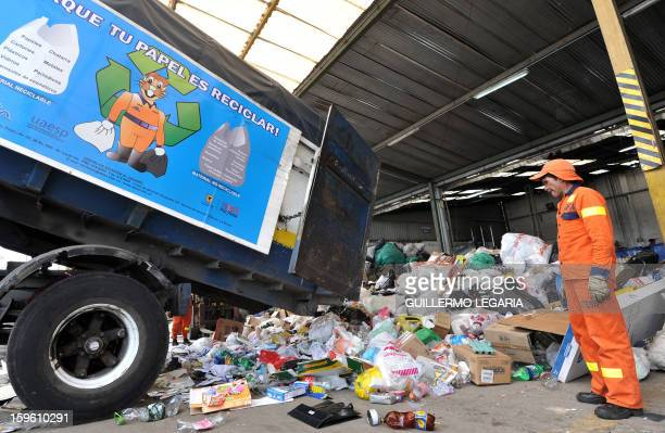 A truck unloads recyclable garbage at La Alqueria Recycling Center in Bogota Colombia on January 17 2013 Some 60 recyclers classify 10 tons daily of...