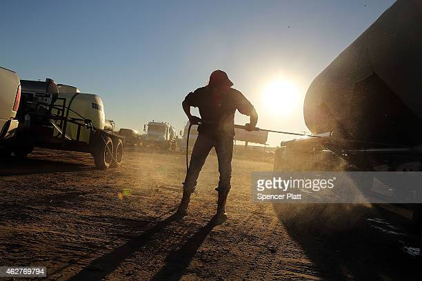 A truck used to carry sand for fracking is washed in a truck stop on February 4 2015 in Odessa Texas As crude oil prices have fallen nearly 60...