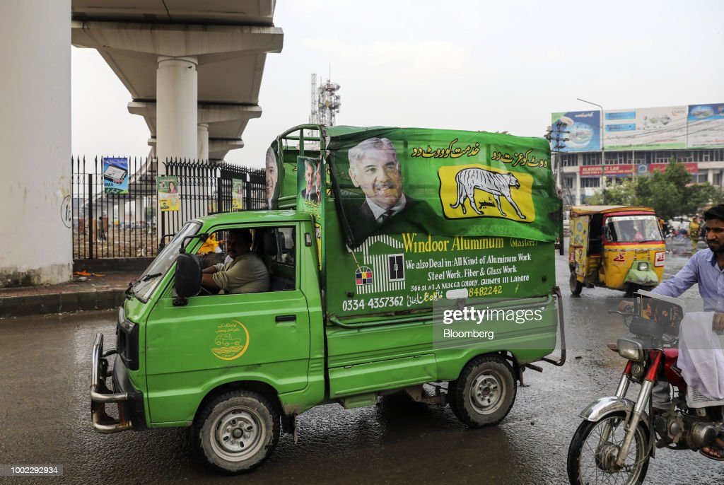 A truck with a campaign banner for Pakistan Muslim LeagueNawaz travels along a road in Lahore Pakistan on Thursday July 17 2018 Whoever wins...