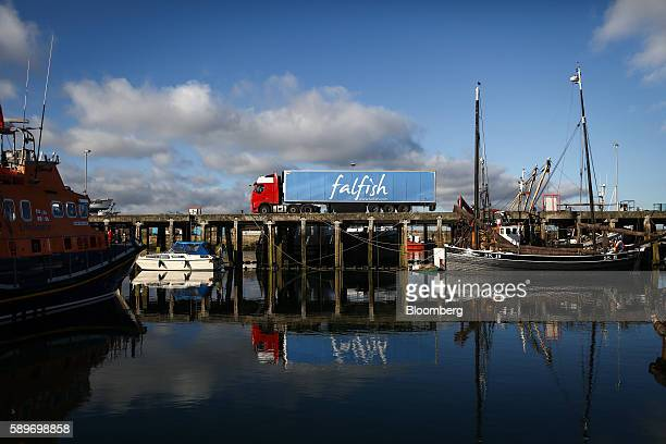 A truck with a Falfish Ltd logo sits parked on the quayside at Newlyn harbour in Newlyn UK on Friday Aug 12 2016 As an island with a long coastline...