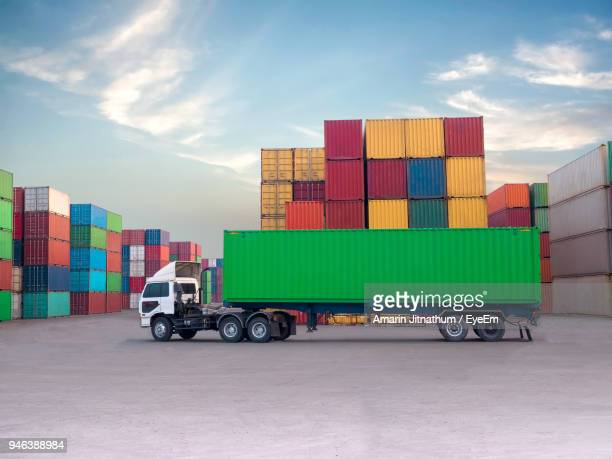 truck with cargo containers at commercial dock against sky - container stock pictures, royalty-free photos & images