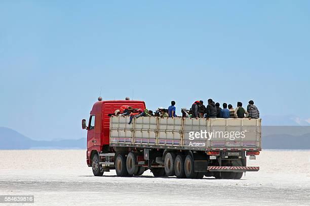 Truck with school children on the salt flat Salar de Uyuni Altiplano Bolivia