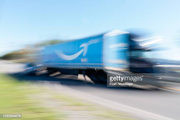 Truck with the Amazon Prime logo on it passes by the Amazon fulfillment warehouse at the center of a unionization drive on March 29, 2021 in...