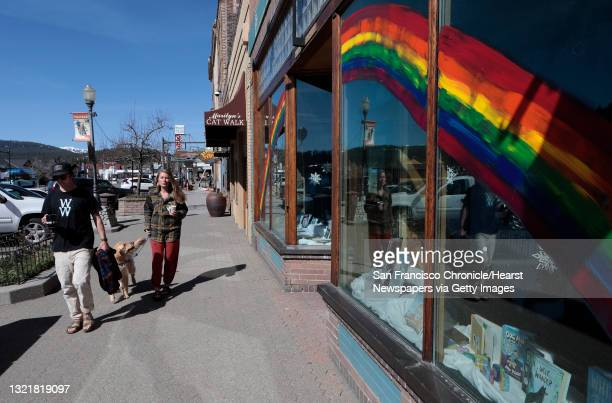 """Truckee residents Tucker Adams and Holly Shankland along with their dog """"Forest"""" take their morning walk for coffee in downtown Truckee, Ca., on..."""