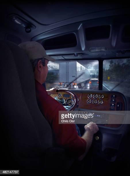 Trucker driving on freeway