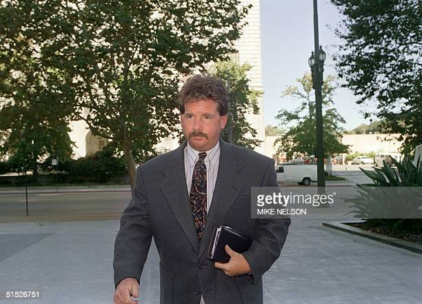 Trucker Reginald Denny arrives at the Federal Building 27 September 1993 in Los Angeles California A judge indicated he will dismiss Denny's 40...