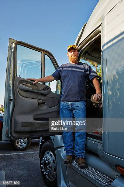 Trucker standing in cab doorway