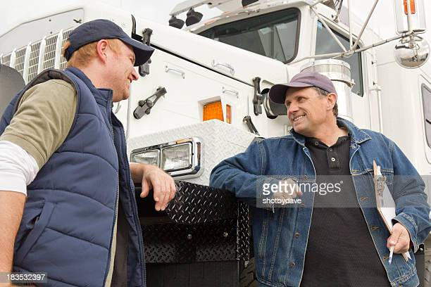 truckers conversation - car transporter stock photos and pictures