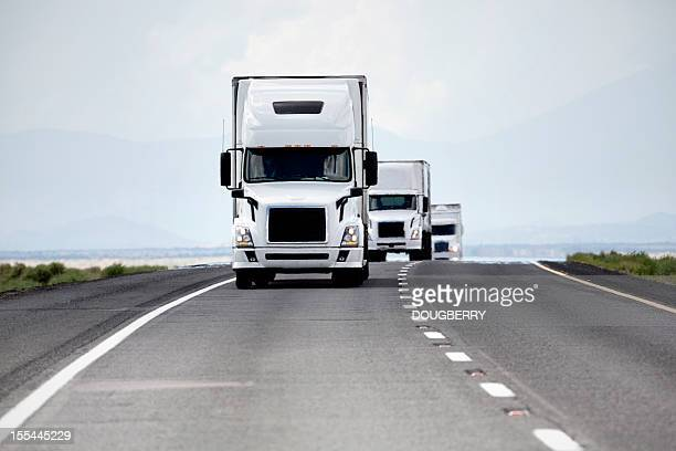 trucking industry - in a row stock pictures, royalty-free photos & images