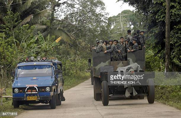 A truckload of Marine soldiers carrying a howitzer cannon travel on the road Indanan town in southern Jolo island on February 12 2009 Civilians have...