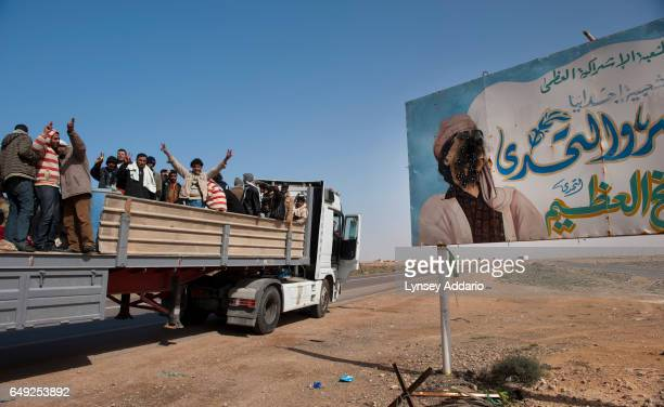 Truckloads of Egyptian men flee from the western parts of the country as opposition soldiers stand on the western edge of Agella the most forward...