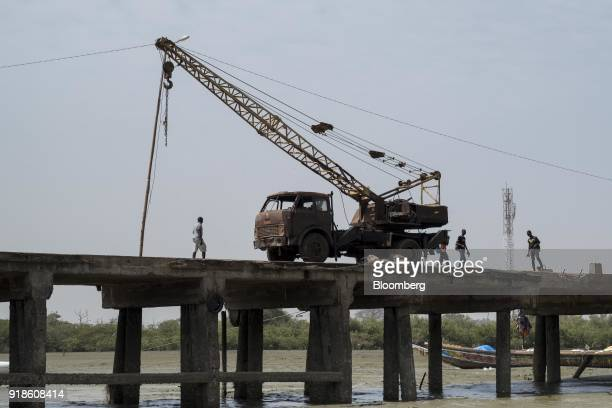 A truckmounted crane stands parked on a jetty by the fishing harbour in the port area of Bissau GuineaBissau on Saturday Feb 10 2018 The...