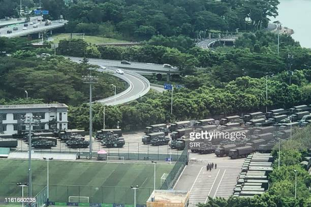 Trucks and armoured personnel carriers are seen outside the Shenzhen Bay stadium in Shenzhen bordering Hong Kong in China's southern Guangdong...