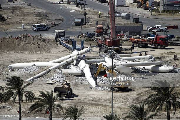 Trucks and bulldozers remove the debris of the Pearl Square monument in Manama on March 19 a day after Bahrain demolished the monument at Pearl...