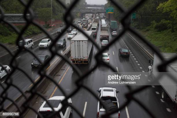 Trucks and cars drive on the Cross Bronx Expressway on May 25, 2017 in the Bronx, New York. The highway is one of the busiest in the nation, and the...